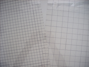 sheets of plastic with grids drawn onto them